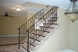 Custom stair rail w forgings, cap rail & volutes
